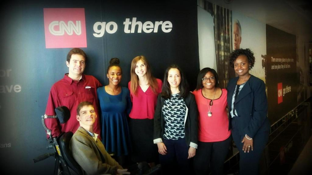 "KSU immersive journalism team at CNN Atlanta in front of ""CNN Go There"" sign"